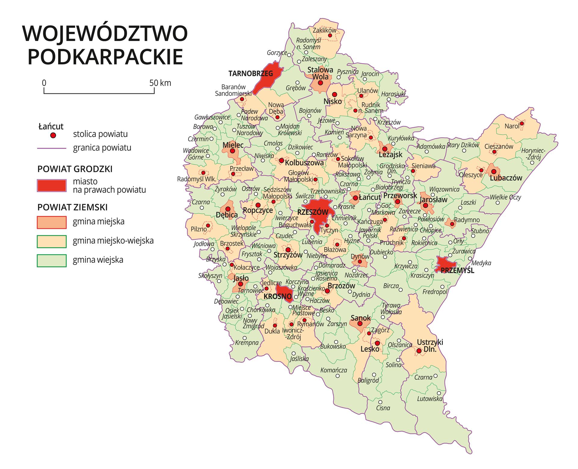 Mapa województwa podkarpackiego. Na mapie fioletowymi liniami zaznaczono granice powiatów ziemskich, dużymi czerwonymi kropkami zaznaczono miasta będące stolicami powiatów. Wobrębie powiatów ziemskich kolorami wyróżniono gminy miejskie, miejsko-wiejskie iwiejskie. Czerwonym kolorem wyróżniono powiaty grodzkie zmiastami na prawach powiatu, miasta te opisano dużymi literami. Kolory iznaki użyte na mapie opisano wlegendzie. Wlegendzie podziałka liniowa.