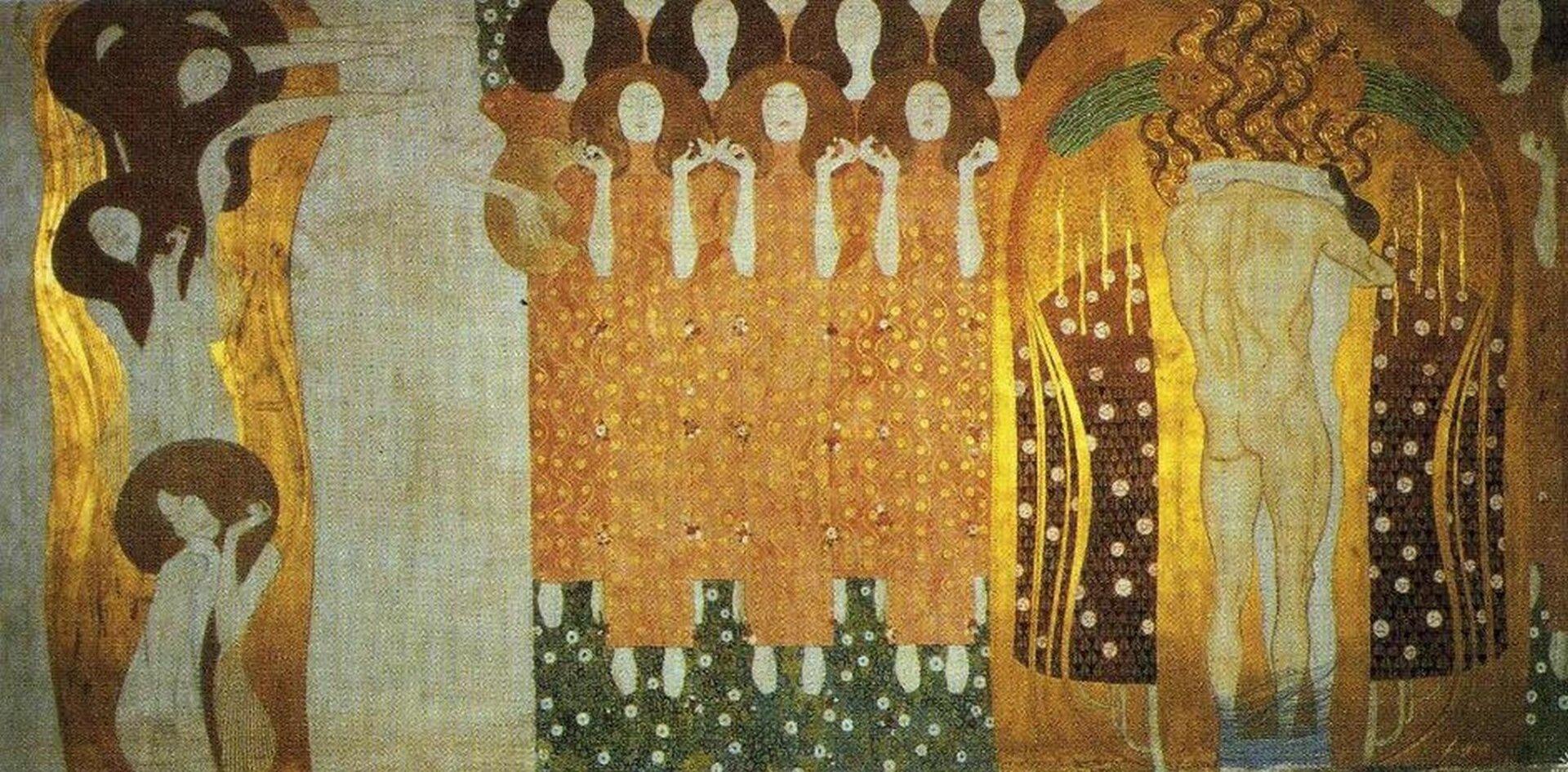 """lustracja przedstawia fresk """"Fryz Beethoven – dążenie do szczęścia znajduje ukojenie wpoezji"""""""" autorstwa Gustawa Klimty. Fresk ukazuje szereg postaci trzymających się za ręce. Zprawej strony widoczny jest odwrócony tyłem nagi mężczyzna."""