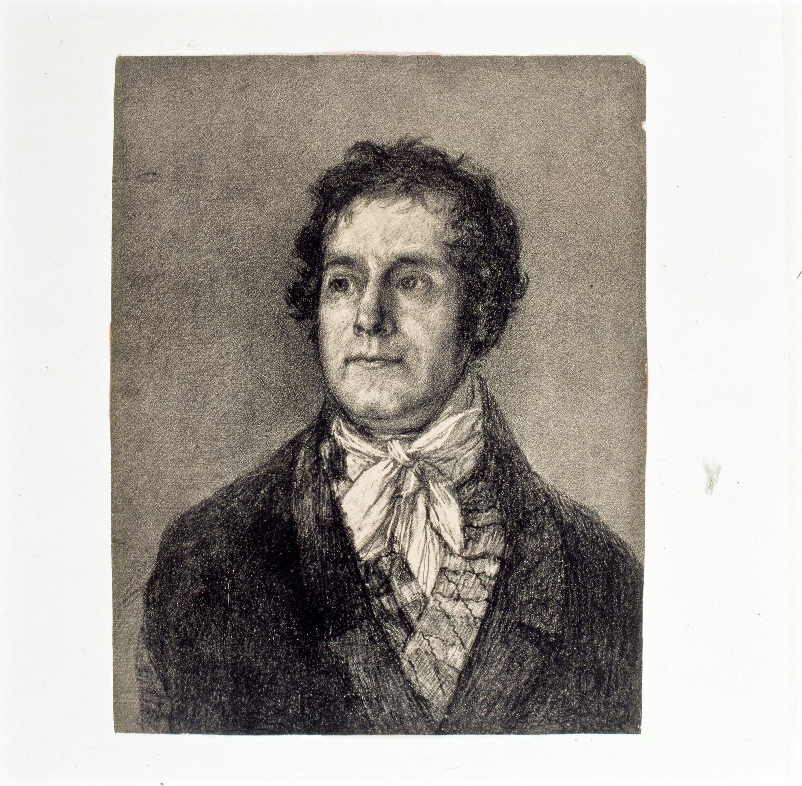 """Ilustracja przedstawia grafikę """"Drukarz Galon"""" autorstwa Francisca Goi. Dzieło ukazuje portret mężczyzny wśrednim wieku, ubranego wciemny płaszcz, kamizelkę oraz białą koszulę. Pod brodą zawiązany ma biały halsztuk (rodzaj chusty). Delikatnie uśmiechnięta postać okrótkich, kręconych włosach, spogląda wlewą stronę. Grafika wykonana jest na szarym papierze za pomocą drobnych ciemnych kresek. Jasne partie ubioru oraz światło układające się na twarzy modela zostały podkreślone za pomocą białej farby drukarskiej. Dzieło skomponowane jest statycznie, postać znajduje się wjego centrum."""