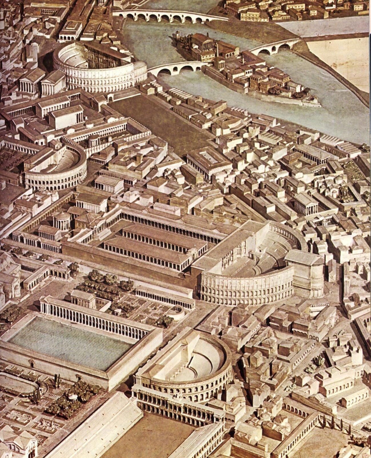 """Ilustracja przedstawia """"Model Pola Marsowego"""" autorstwa The Pompey Project iprzedstawia komputerową wizualizację Pola Marsowego, na którym znajdują się teatry, place oraz liczne budowle.  Wgórnej-prawej części ilustracji znajduje się rzeka oraz mosty, które łączą brzegi miasta Rzymu."""