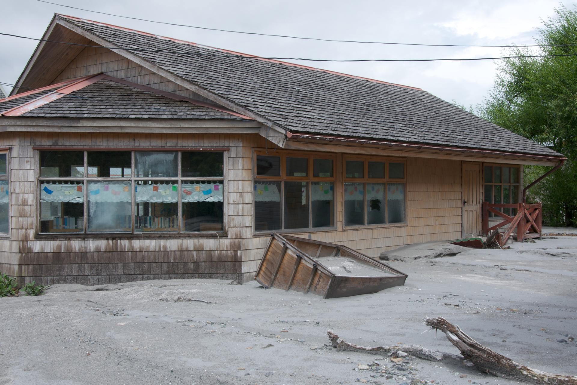Zdjęcie przedstawiające dom oraz powódź błotną