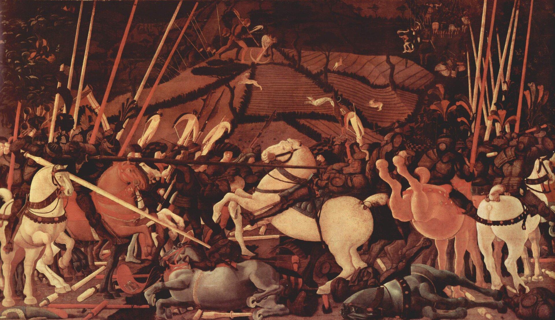 """Ilustracja przedstawia obraz Paola Uccella """"Bitwa pod San Romano"""". Ukazuje scenę bitwy. Postacie na koniach znajdujące się na pierwszym planie są stłoczone. Niektóre konie leżą powalone na ziemię, inne stają dęba. Na ziemi leży wiele włóczni. Nad sceną sterczą długie lance. Tło obrazu przedstawia wzgórze, na którym biegają zwierzęta oraz znajdują się myśliwi zkuszami."""