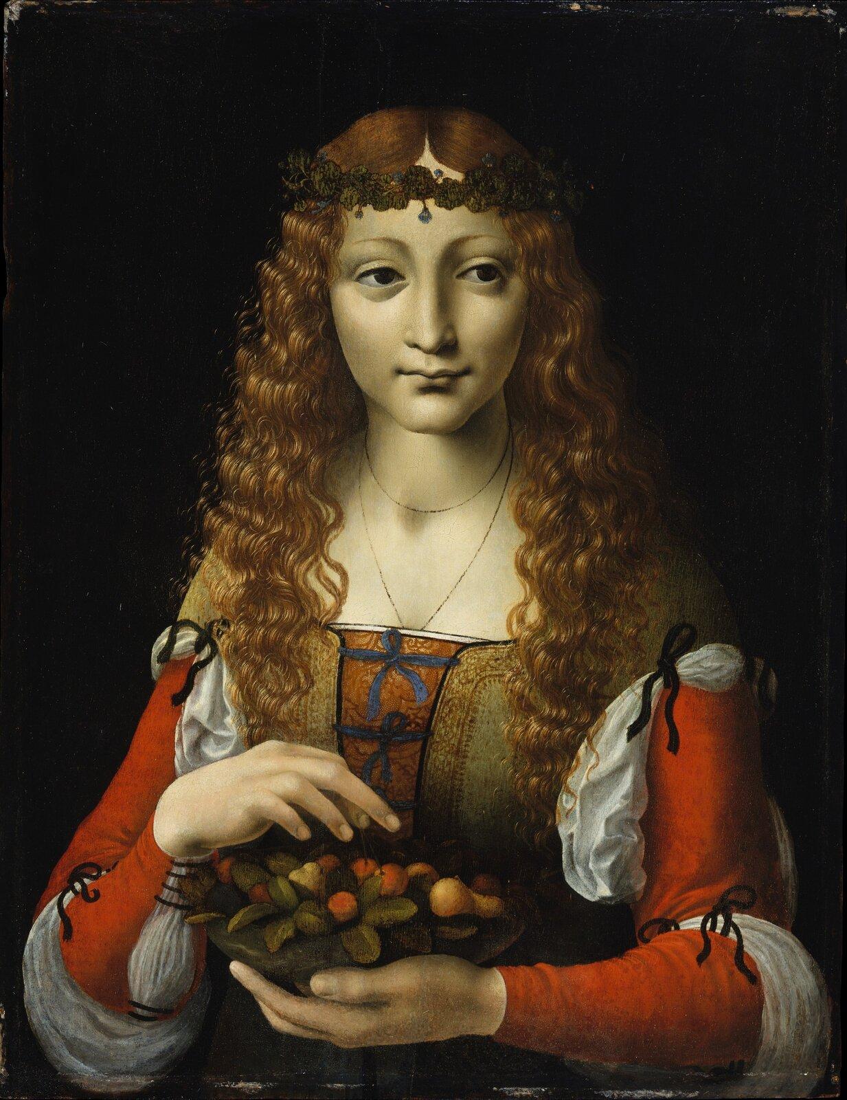 """Ilustracja przedstawia obraz """"Dziewczyna zwiśniami"""" autorstwa Ambrogio de Predisa. Dzieło ukazuje portret młodej kobiety trzymającą naczynie zowocami wlewym ręku. Prawa ręka postaci zawieszona jest nad wiśniami. Dziewczyna ubrana jest wsuknię zczerwono-białymi rękawami iwiązanym zprzodu, zielono-pomarańczowym gorsetem. Ngłowie ma wianek, spod którego spływają na ramiona drobne fale rudych włosów. Ciemne oczy spoglądają wlewą stronę. Delikatny uśmiech ust podkreśla łagodność wizerunku. Postać umieszczona jest na ciemnym tle. Artysta zdużym realizmem idbałością ukazał każdy detal obrazu. Dzieło wykonane jest techniką olejną na desce."""