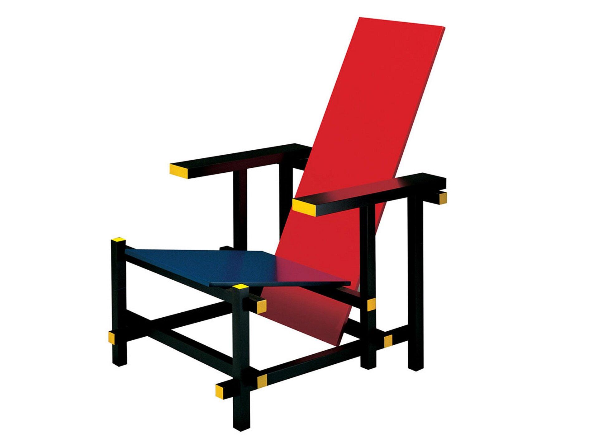Ilustracja przedstawia czerwono-niebieskie krzesło zaprojektowane przez Gerrita Rietvelda. Mebel jest kanciasty, posiada ostre krawędzie. Siedzisko fotela jest niebieskie, oparcie natomiast czerwone. Zarówno siedzisko jak ioparcie nie są ułożone wkącie prostym, są one przechylone tworząc kąt rozwarty.