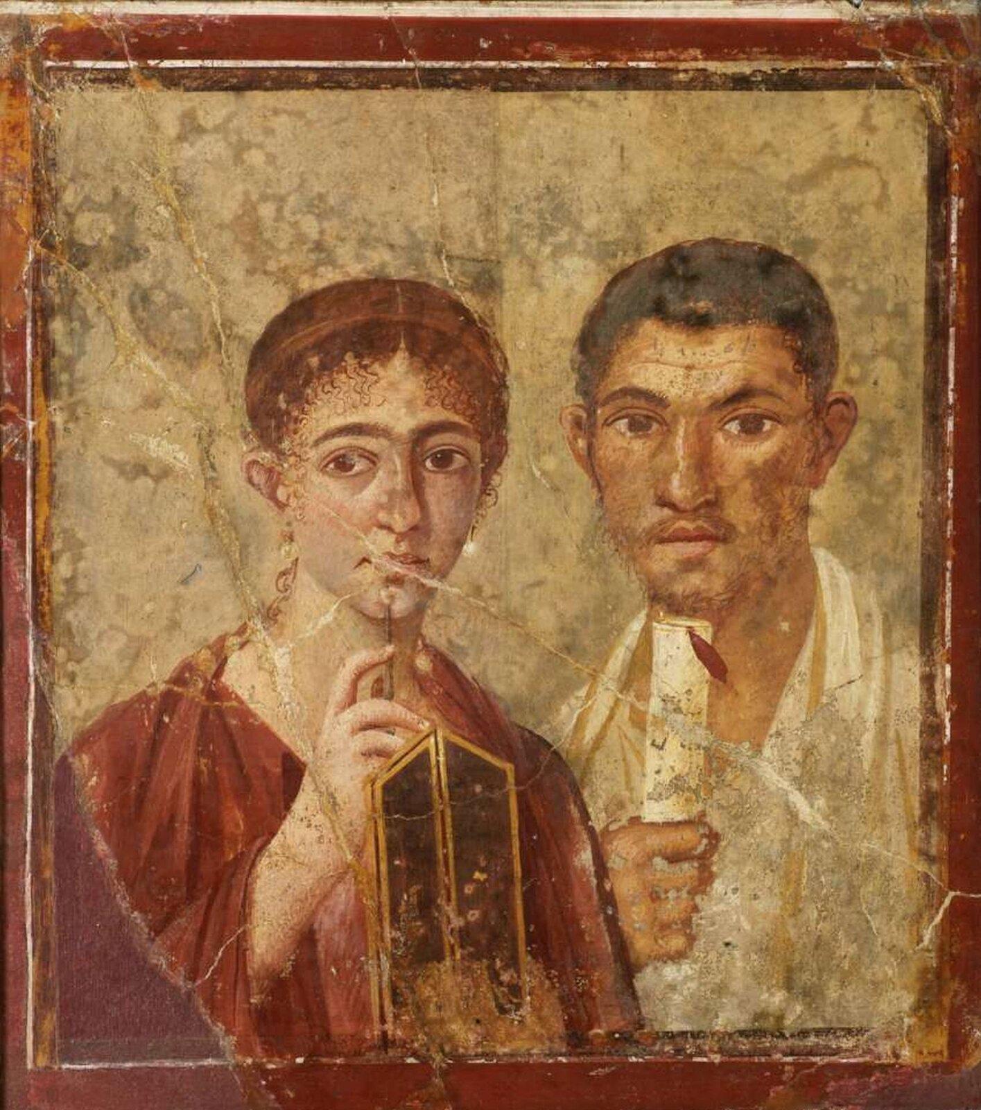 """Fresk nieznanego autora pod tytułem """"Terentius Neo ijego żona"""" przedstawia portret małżonków. Kobieta ma długie rude włosy spięte wkok. Wdłoni trzyma drewniane pudełko.Obok niej stoi mężczyzna okrótkich włosach izaroście. Wręku trzyma zwój papirusowy. Oboje mają duże oczy ispoglądają przed siebie."""