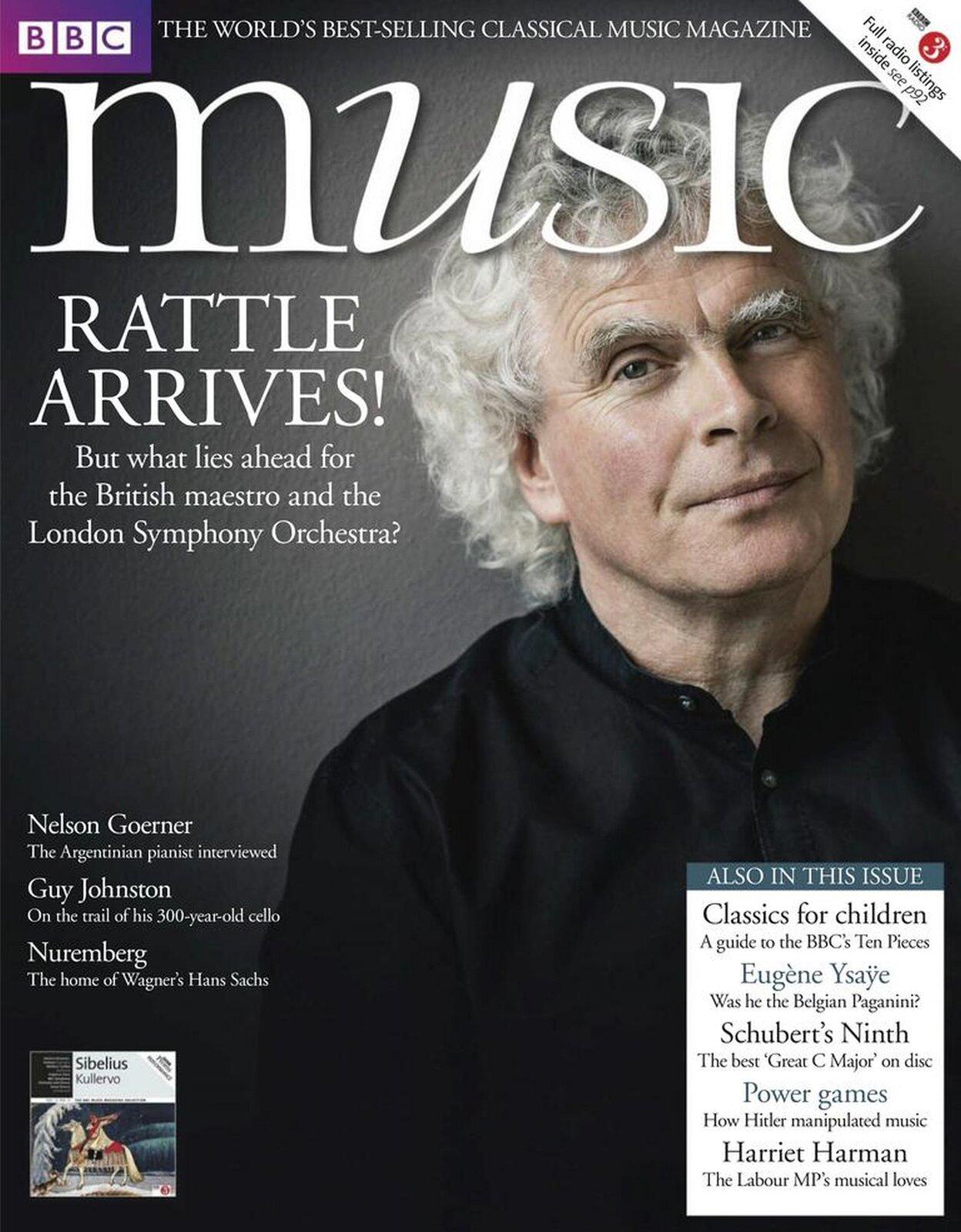 """Ilustracja przedstawia okładkę czasopisma muzycznego """"BBC Music Magazine"""". Na okładce znajduje się mężczyzna wśrednim wieku. Ma lekko uśmiechniętą twarz, włosy dłuższe, lokowane, siwe. Ubrany jest wczarną koszulę."""