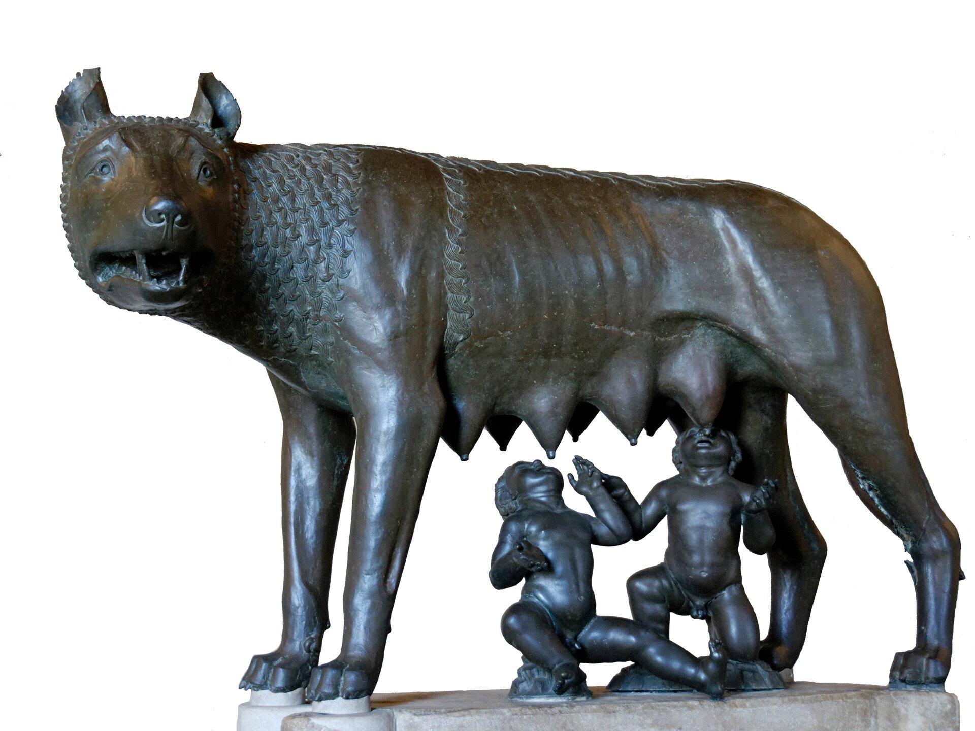 Lupa Capitolina: Wilczyca zRomulusem iRemusem Rzeźba zVw. n.e. znajdująca się wMuzeum Kapitolińskim wRzymieprzedstawia wilczycę karmiącą Romulusa iRemusa. Źródło: Lupa Capitolina: Wilczyca zRomulusem iRemusem, Muzea Kapitolińskie, domena publiczna.
