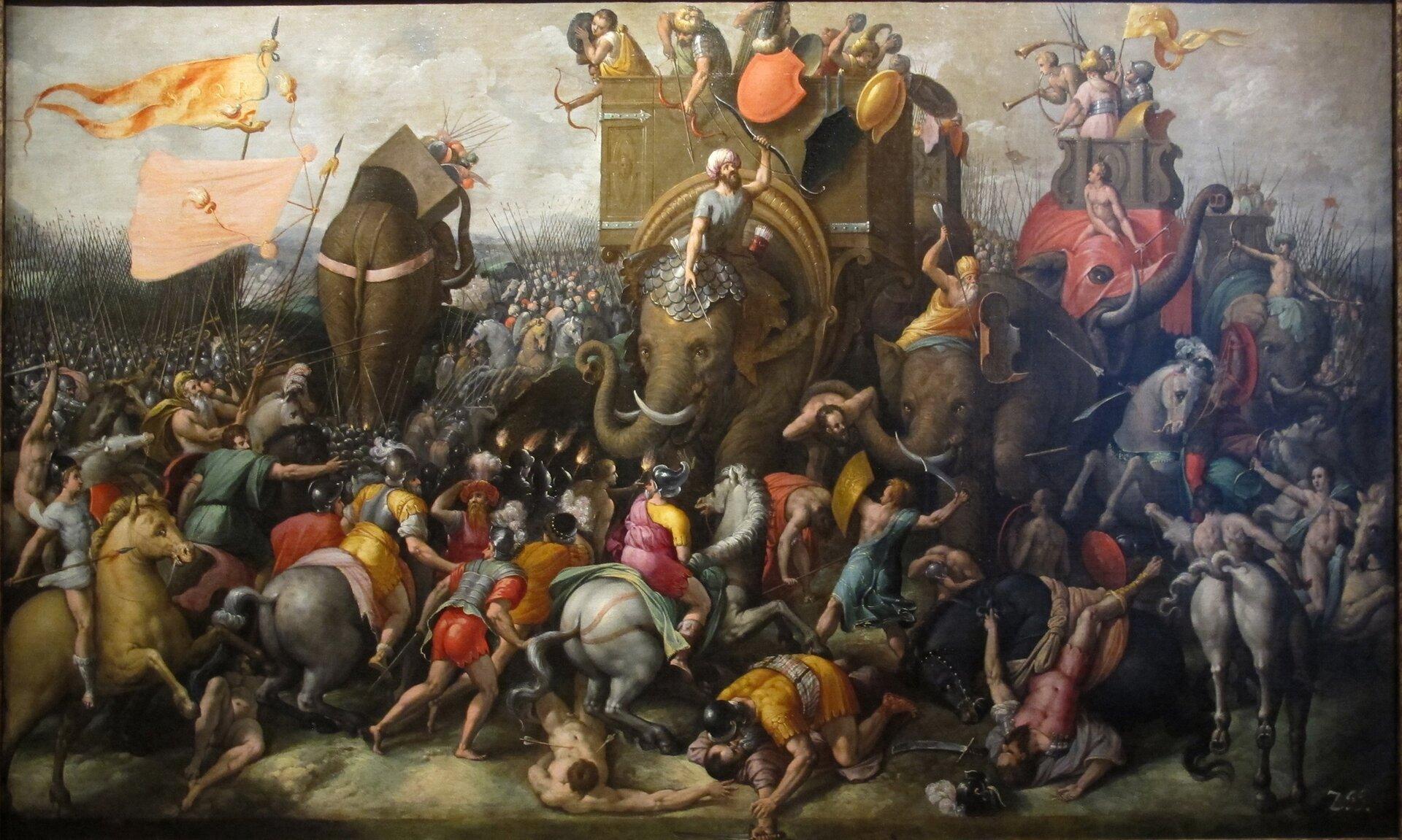 """Kolorowa ilustracja ukazuje dzieło Cornelisa Corta pt. """"Bitwa pod Zamą"""". Jest to scena starcia wojsk rzymskich zpunickimi. Wcentralnej części obrazu znajdują się wojownicy jadący na słoniach. Dwa słonie ukazane są zprzodu, jeden, na drugim planie, tyłem. Na pierwszym planie walczy konnica. Na ziemi leżą martwi iranni żołnierze. Nad walczącymi powiewają chorągwie."""