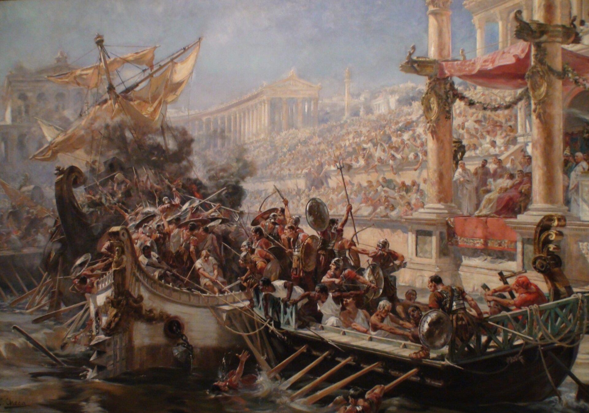 Ilustracja przedstawia obraz Ulpiano Checa pod tytułem Naumachia. Ukazuje ona walkę czterech statków podczas igrzysk wCircus Maximus. Statki wypełnione są uzbrojonymi gladiatorami. Całość ztrybun obserwuje tłum.